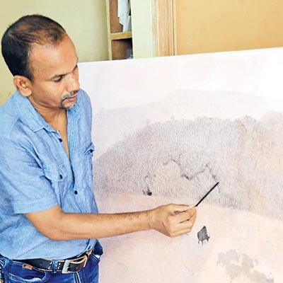 Anukul paints on his canvas