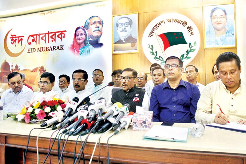 Awami League General Secretary and Road Transport and Bridges Minister Obaidul Quader speaking to reporters at the party's Bangabandhu Avenue Central Office in the capital on Tuesday.	photo : Observer