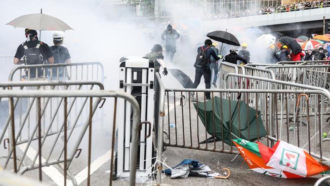 Hong Kong police fire tear gas, water as protest escalates