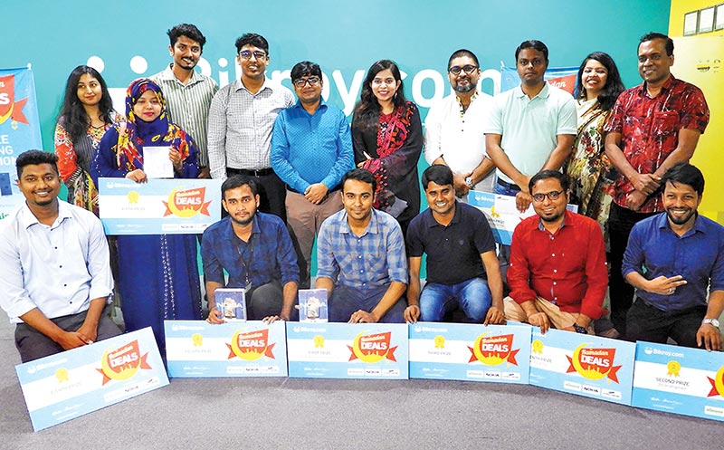 Oranisers along with prize winners of Ramadan Deals' campaign of Bikroy.com pose for photograph at the prize giving ceremony in Dhaka on Wednesday.