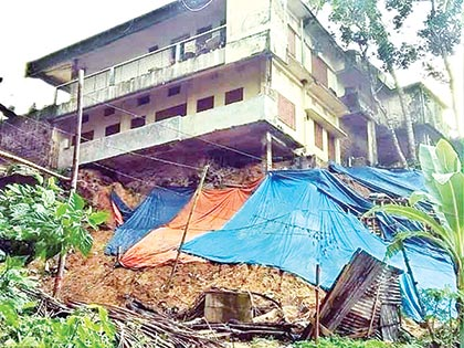 Damaged structure in hill slides in Rangamati town