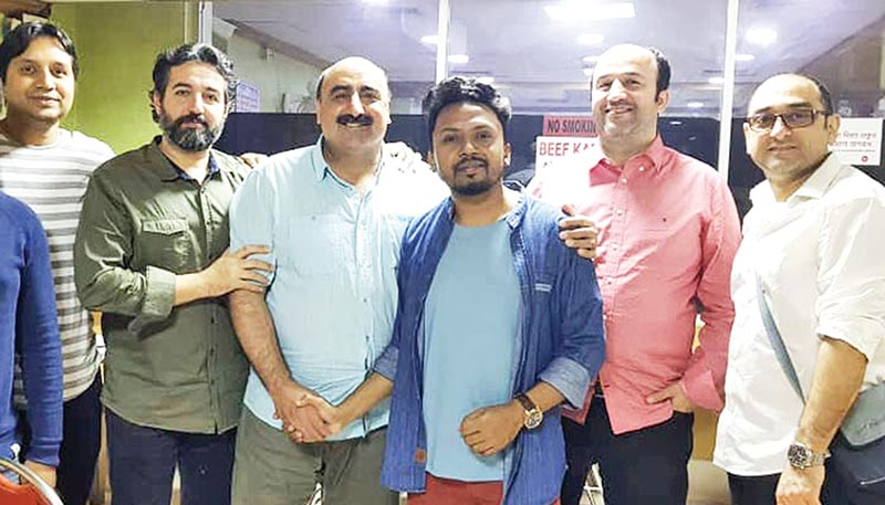 Belal Khan (3rd from right) with Iranian crew members of the song