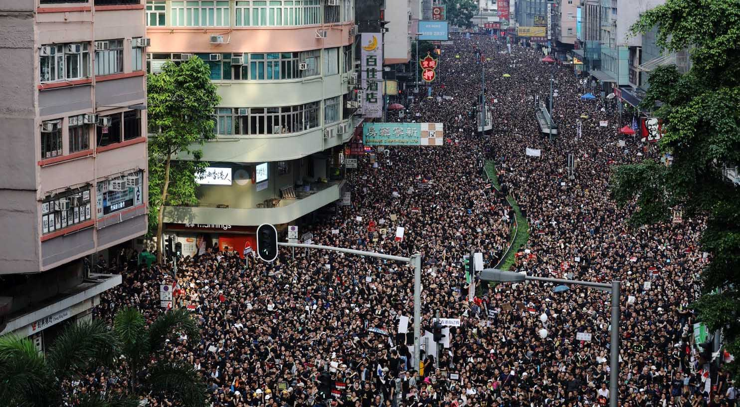 Demonstrators march Sunday in Hong Kong. (Kyle Lam/Bloomberg)