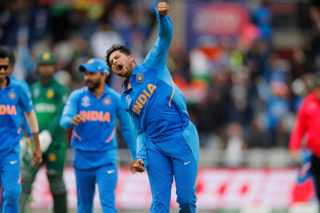 India's Kuldeep Yadav celebrates the wicket of Pakistan's Babar Azam. Photograph: Tom Jenkins/The Guardian
