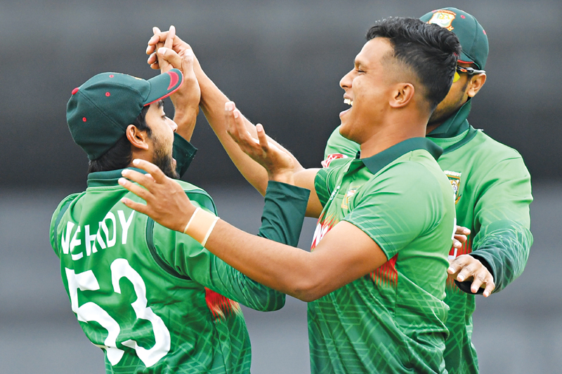 Bangladesh's Mohammad Saifuddin (R) celebrates taking the wicket of West Indies' Chris Gayle for 0 runs during the 2019 Cricket World Cup group stage match between West Indies and Bangladesh at The County Ground in Taunton, southwest England, on June 17, 2019.	photo: AFP