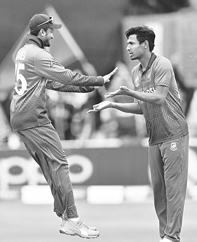 Bangladesh's Mustafizur Rahman (R) celebrates with Bangladesh's Shakib Al Hasan after taking the wicket of West Indies' Andre Russell during the 2019 Cricket World Cup group stage match between West Indies and Bangladesh at The County Ground in Taunton, southwest England, on June 17, 2019.