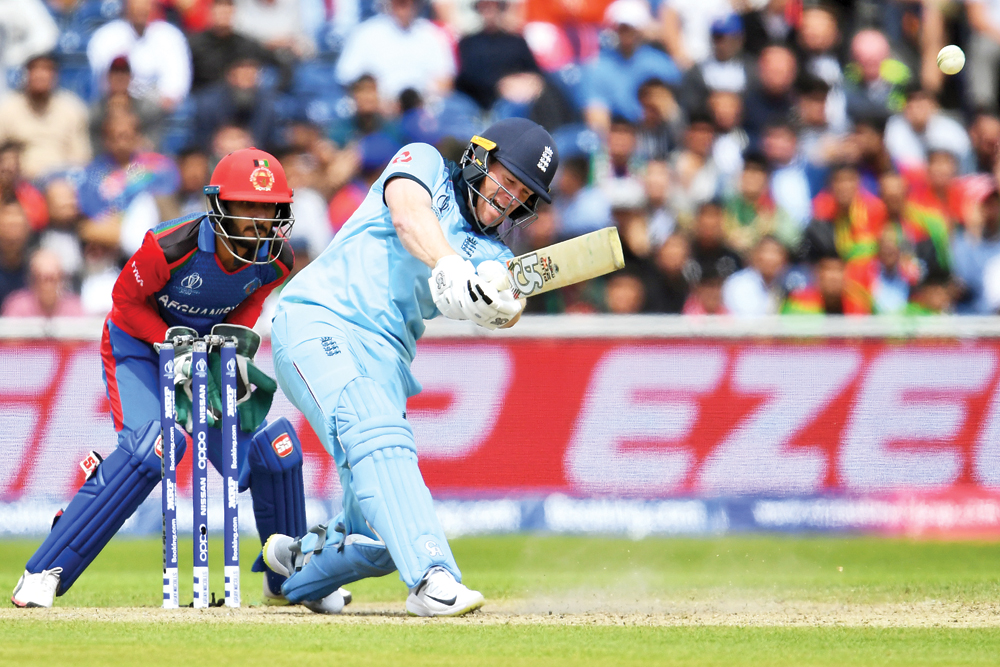England's captain Eoin Morgan plays a shot during the 2019 Cricket World Cup group stage match between England and Afghanistan at Old Trafford in Manchester, northwest England, on June 18. 	Photo: AFP
