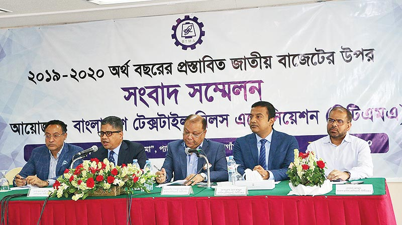 BTMA President Mohammad Ali Khokon flanked by other leaders of the association speaking at a press conference at Pan Pacific Sonargaon hotel in the city on Wednesday.