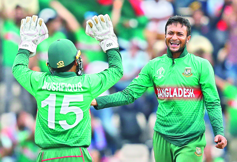 Shakib Al Hasan (R) celebrates with teammate Mushfiqur Rahim after the dismissal of Afghanistan's Najibullah Zadran during the 2019 Cricket World Cup group stage match between Bangladesh and Afghanistan at the Rose Bowl in Southampton, southern England, on June 24.Photo: AFP
