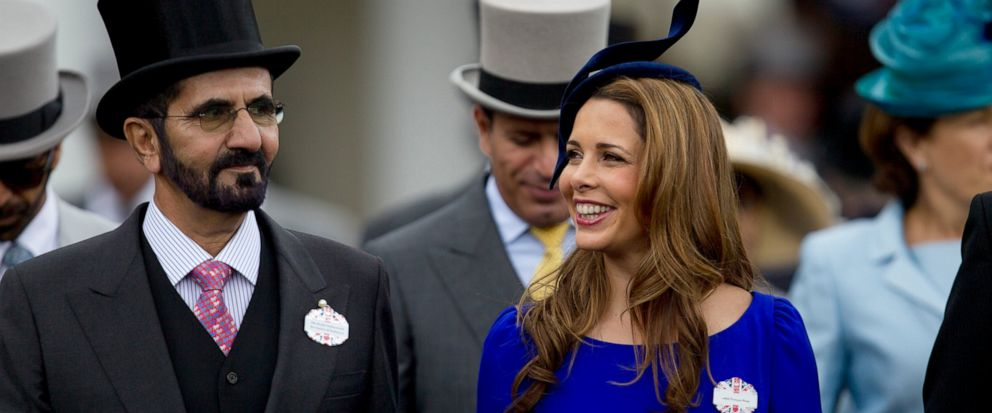 FILE - In this Wednesday, June 20, 2012 file photo, Sheikh Mohammed Al Maktoum and his wife Princess Haya of Jordan walk towards the paddock on the second day of Royal Ascot horse race meeting at Ascot, England. A legal battle between the powerful, poetry-writing ruler of Dubai and his wealthy estranged wife is leading toward a showdown in a London courtroom later this month. The family division court case scheduled on July 30 pits Sheikh Mohammed bin Rashid Al Maktoum against Princess Haya, daughter of the late King Hussain of Jordan and an accomplished Olympic equestrian on friendly terms with horse aficionado Queen Elizabeth II. (AP Photo/Alastair Grant, File)