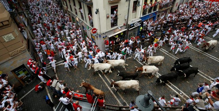 Three people gored in bull-running festival
