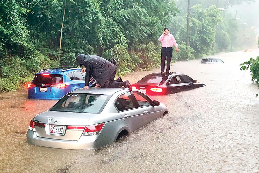 Motorists are stranded on a flooded section of Canal Road in Washington during a heavy rainstorm on July 8.	 �Photo: AP