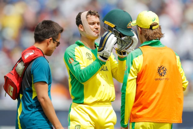 Carey gets the bandage treatment from the team doctor. Photograph: Tom Jenkins/The Guardian