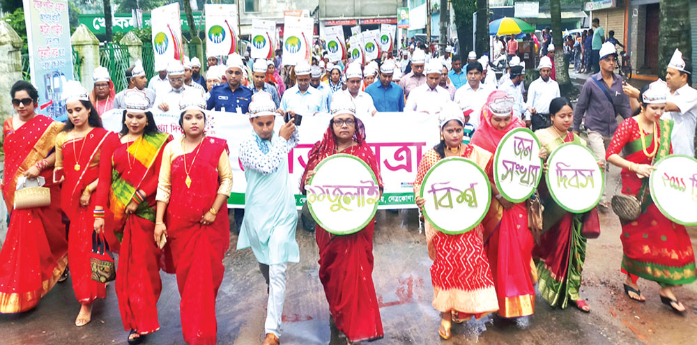 To mark the World Population Day, a colourful rally was brought out in Netrakona town on Thursday. 	photo: Observer