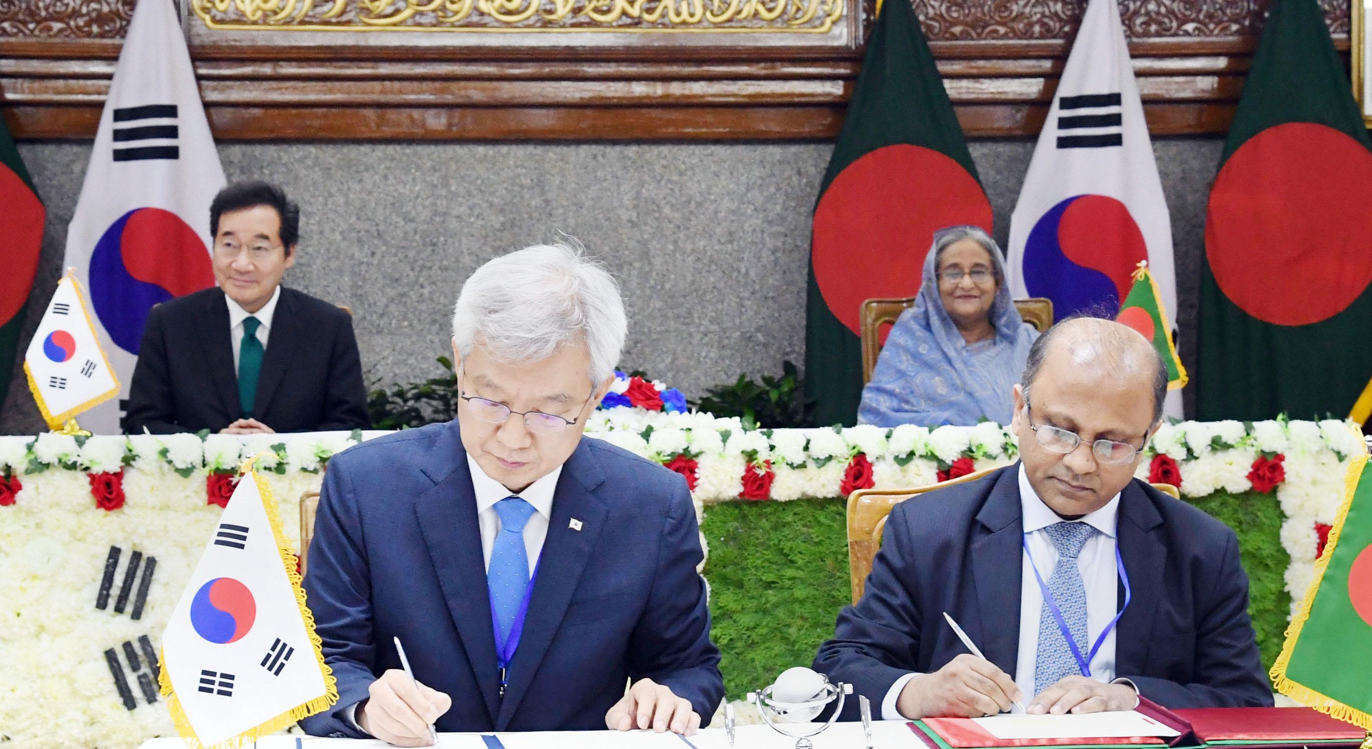 Dhaka, Seoul sign 3 instruments