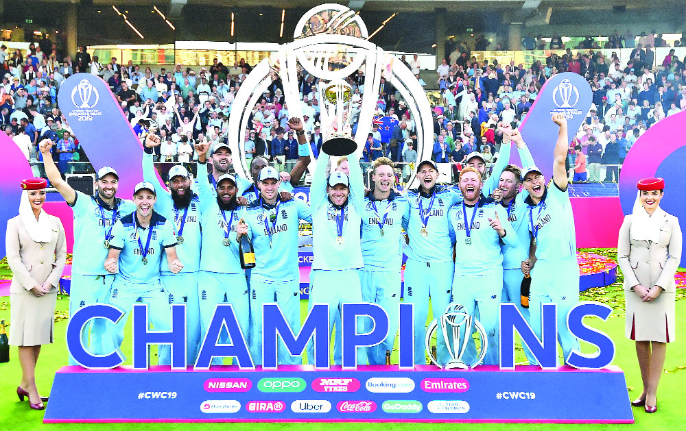 England's captain Eoin Morgan lifts the World Cup trophy as England's players celebrate their win after the 2019 Cricket World Cup final between England and New Zealand at Lord's Cricket Ground in London on July 14. England won the World Cup for the first time as they beat New Zealand in a Super Over after a nerve-shredding final ended in a tie at Lord's. Photo: AFP