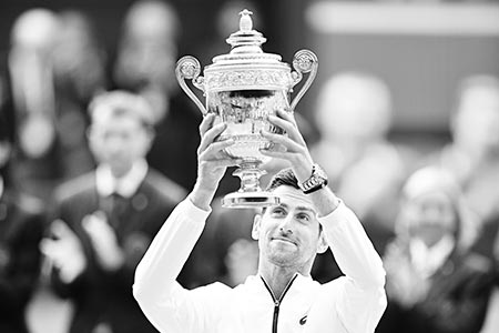 Serbia's Novak Djokovic raises the winner's trophy after beating Switzerland's Roger Federer during their men's singles final on day thirteen of the 2019 Wimbledon Championships at The All England Lawn Tennis Club in Wimbledon, southwest London, on July 14, 2019.	photo: AFP