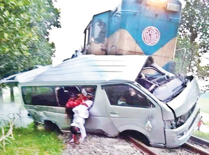 A train smashed a microbus at an unmanned level crossing at Panchakohsi in Ullapara upazila on Monday evening where nine people were killed and seven others injured. photo: UNB