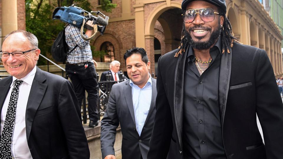 West Indies cricketer Chris Gayle reacts as he leaves the New South Wales Supreme Court after winning a defamation case against an Australian media company in Sydney.(REUTERS)