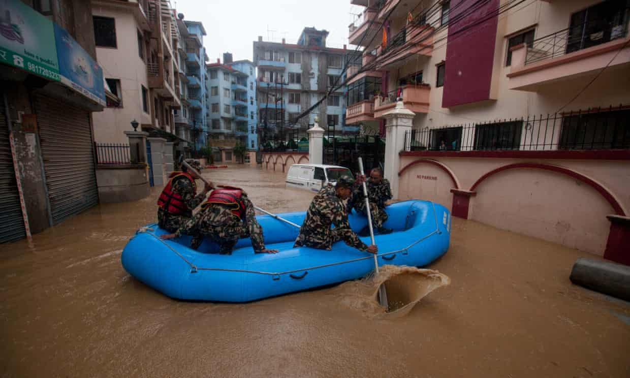 Nepalese army personnel rescue people after a heavy rainfall in Kathmandu, Nepal.