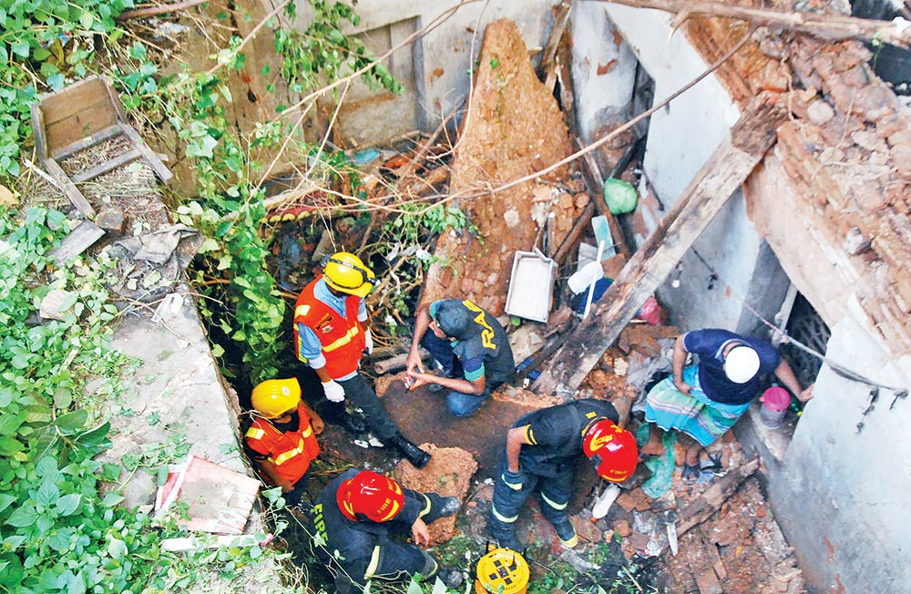 Rescue operations going on after a two-storey building collapsed at Pathantoli in Old Dhaka on Wednesday.photo : Observer