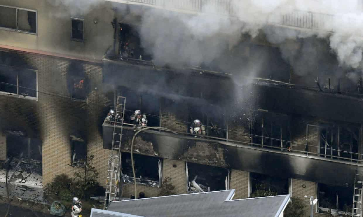 Firefighters at the Kyoto Animation building. Photograph: Kyodo/Reuters