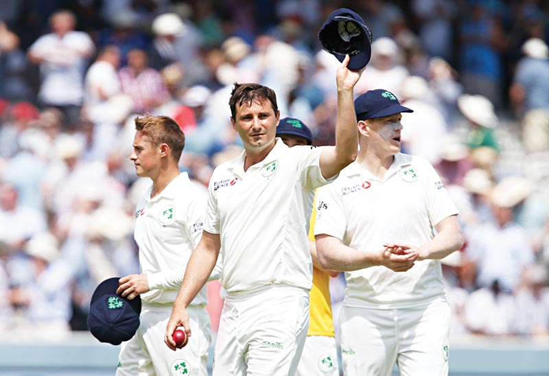 Ireland's Tim Murtagh walks off the field after taking 5 wickets and leaving England to bowl on the first day of the first cricket Test match between England and Ireland at Lord's cricket ground in London on July 24, 2019.photo: AFP
