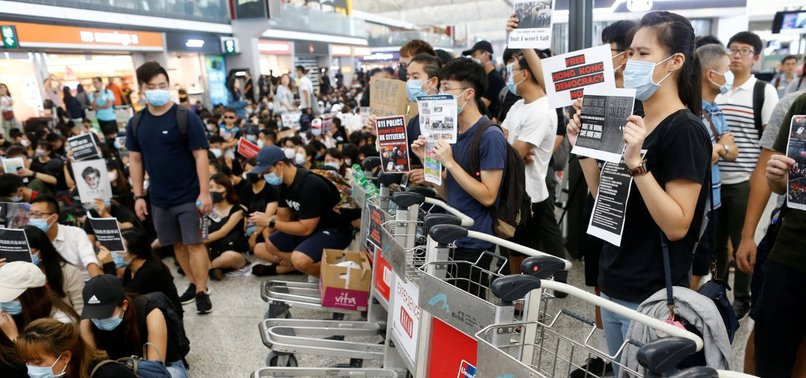 Protesters clog Hong Kong airport again after it reopens