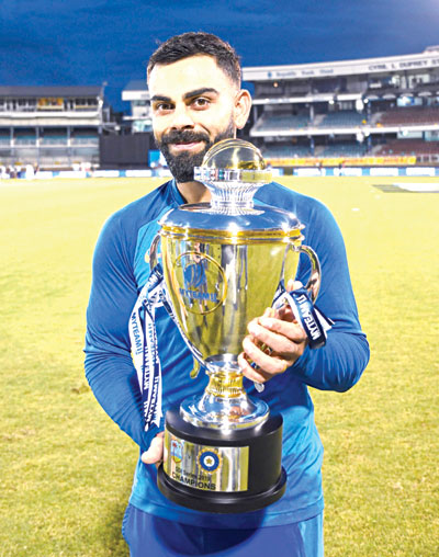 India's Virat Kohli poses with the trophy after India won the 3rd and final ODI match against West Indies at Queens Park Oval, Port of Spain, Trinidad and Tobago, on August 14, 2019.	photo: AFP