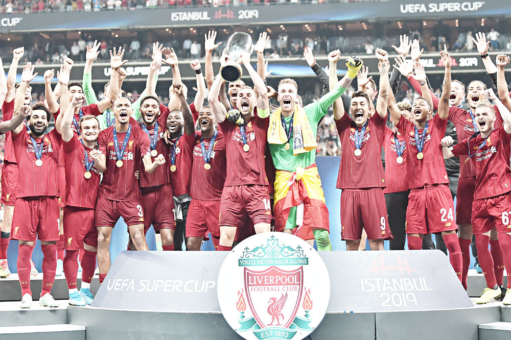 Liverpool players celebrate with the trophy after winning the UEFA Super Cup 2019 football match between FC Liverpool and FC Chelsea at Besiktas Park Stadium in Istanbul on August 14, 2019.photo: AFP