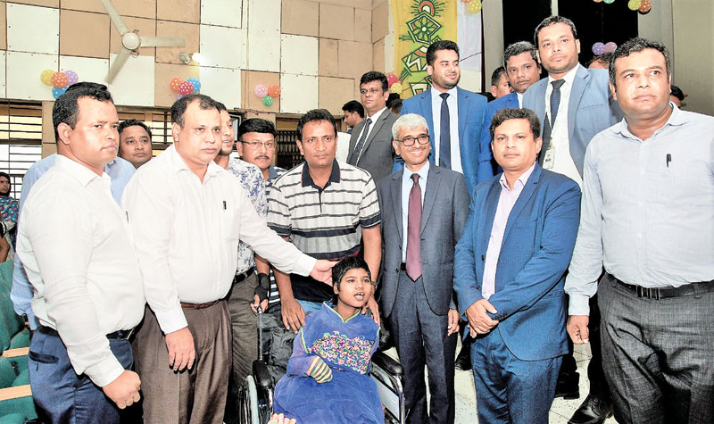 'Wheelchair distribution' programme of LankaBangla Finance Limited (LBFL)