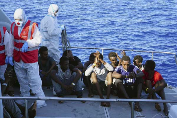 9 migrants jump into sea trying to reach Italy