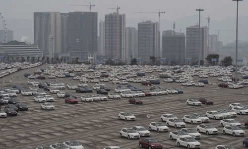 A parking lot where completed Ford models are stored for shipment, in Chongqing, China