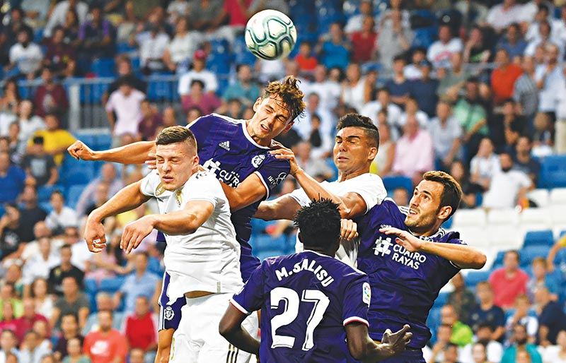 (FromL) Real Madrid's Serbian forward Luka Jovic, Valladolid's Turkish forward Enes Unal, Valladolid's Ghanaian defender Mohammed Salisu, Real Madrid's Brazilian midfielder Casemiro and Valladolid's Spanish defender Kiko jump for the ball during the Spanish League football match between Real Madrid and Real Valladolid at the Santiago Bernabeu stadium in Madrid on August 24, 2019.photo: AFP