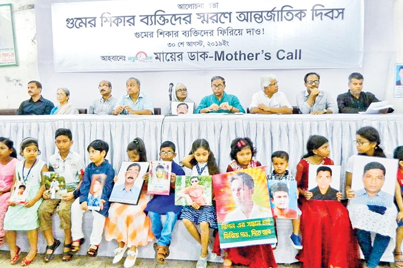 Rights organisation Mayer Daak holds a discussion on the occasion of the International Day of the Victims of Enforced Disappearances at the National Press Club in Dhaka on Friday. Children of the victims demanded return of their fathers by holding their photos at the programme.	photo: observer