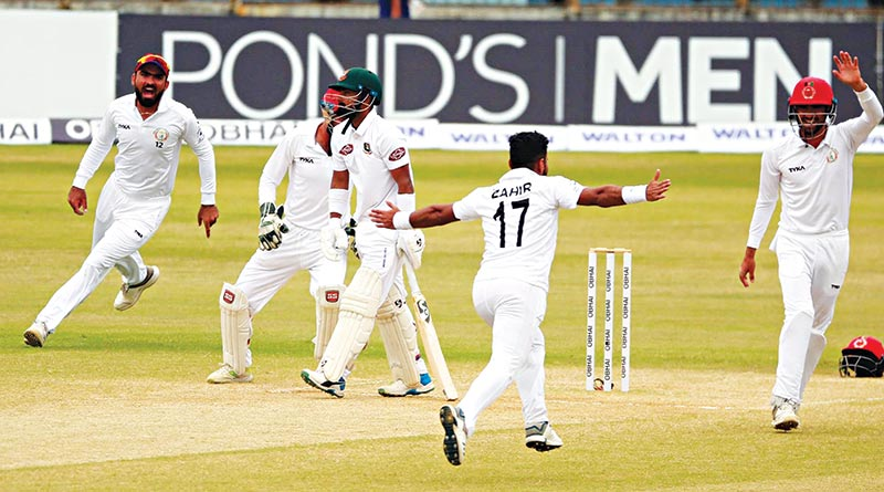 Players of Afghanistan celebrating the wicket of Liton Das of Bangladesh on day-4 of the only Test match at the Zahur Ahmed Chowdhury Stadium in Chattogram on Sunday. 	photo: BCB