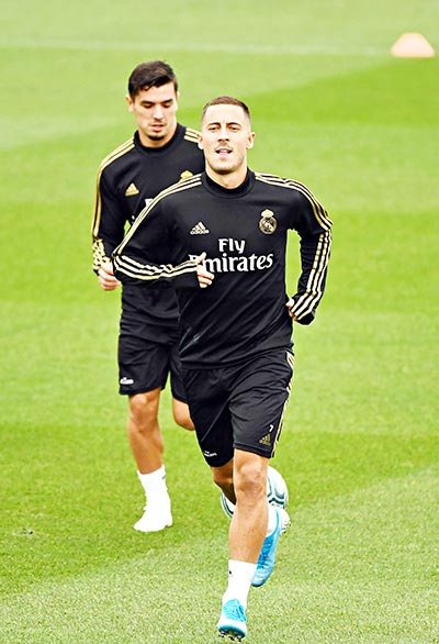 Real Madrid's Belgian forward Eden Hazard (FRONT) attends a training session at the Ciudad Real  Madrid training ground in Valdebebas, Madrid, on September 13, 2019.photo: AFP