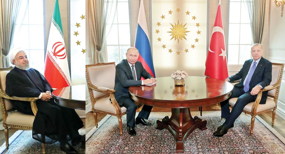 Turkish President Recep Tayyip Erdogan (R) and Russian President Vladimir Putin (L) posing before their meeting at the Presidential Palace in Ankara, on September 16. Left: Iranian President Hassan Rouhani pose before meeting with Erdogan at the Presidential Palace in Ankara.photo : AFP