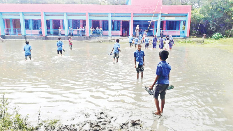 Students suffer for water-logging at Monpura school
