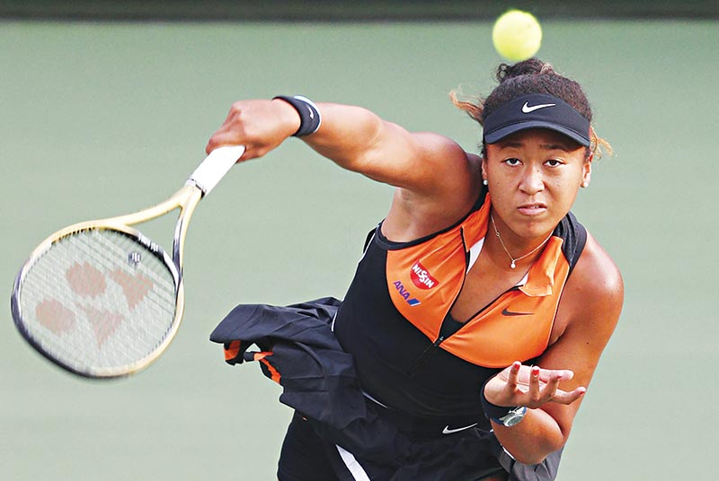 Japan's Naomi Osaka serves against Belgium's Elise Mertens during their women's singles semi-final match at the Pan Pacific Open tennis tournament in Osaka on September 21, 2019.