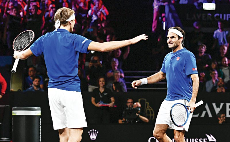 Team Europe's Roger Federer (R) and Alexander Zverev celebrate their victory over Team World's Denis Shapovalov and Jack Sock during their double match as part of the 2019 Laver Cup tennis tournament in Geneva, on September 20, 2019.