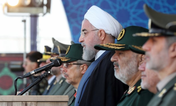 Iranian president Hassan Rouhani, centre, watches the annual military parade. Photograph: Iranian presidential office/EPA