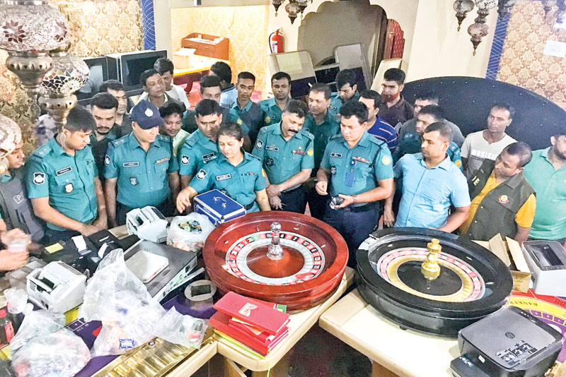 The lawmen seized gambling boards, gambling equipment, walkie talkie, knives and liquor from Mohammedan Sporting Club during a drive in the capital's Motijheel area on Sunday.PHOTO: OBSERVER