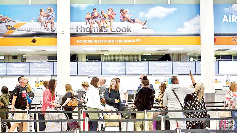 British travel firm Thomas Cook collapses, leaving hundreds of thousands stranded