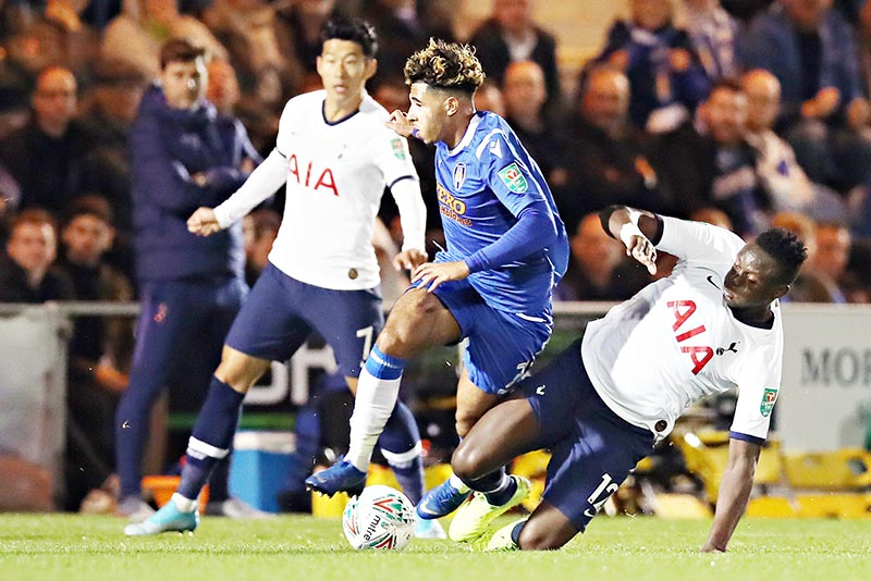 Tottenham Hotspur's Kenyan midfielder Victor Wanyama (R) and Tottenham Hotspur's South Korean striker Son Heung-Min (L) vie with Colchester United's English midfielder Courtney Senior during the English League Cup third round football match between Colchester United and Tottenham Hotspur at the Colchester Community stadium in Colchester, eastern England, on September 24, 2019.photo: AFP