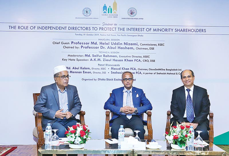 BSEC Commissioner Professor Md Helal Uddin Nizami (middle), BSEC Chairman Professor Dr Abul Hashem (left) and The DSE Acting Managing Director Abdul Matin Patwary attend a seminar on World Investors Day 2019 in Dhaka on Tuesday.