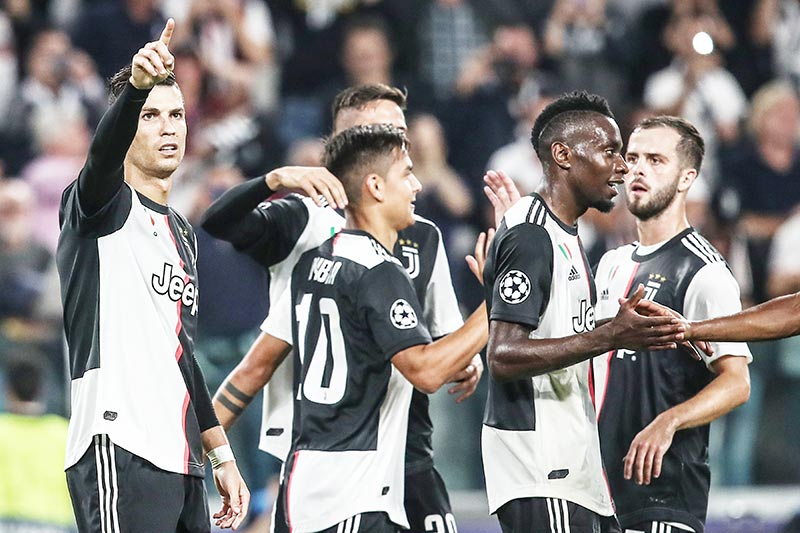 Juventus' Portuguese forward Cristiano Ronaldo (L) celebrates after scoring during the UEFA Champions League Group D stage football match Juventus vs Bayer Leverkusen on October 1, 2019 at the Juventus stadium in Turin.photo: AFP