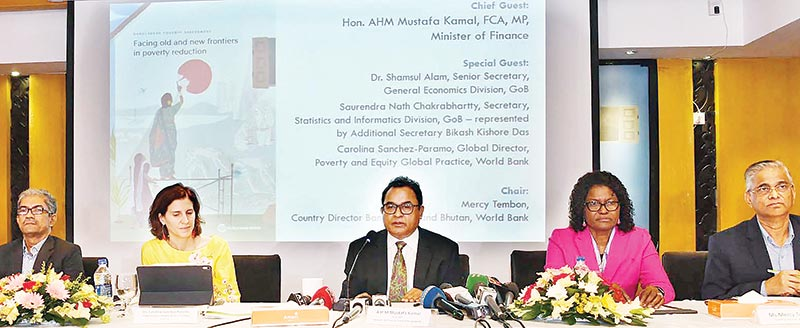Finance Minister AHM Mustafa Kamal (middle) flanked among others by WB Country Director for Bangladesh and Bhutan Mercy Tembon (2nd from right) speaking as the chief guest at the launching of a World Bank report in Dhaka on Monday.
