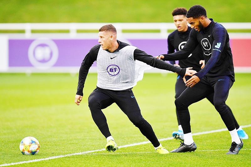 England's midfielder Ross Barkley (L) vies with England's midfielder Jadon Sancho (C) and England's defender Joe Gomez as they attend an England team training session at St George's Park in Burton-on-Trent, central England on October 7, 2019, ahead of their Euro 2020 football qualification match against the Czech Republic.	photo: AFP
