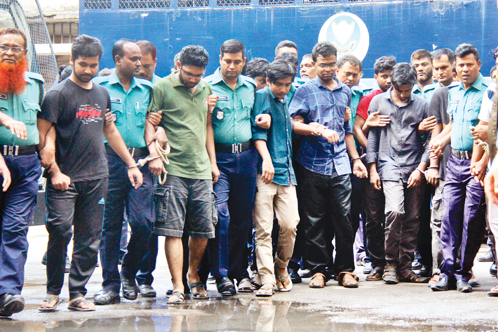 Ten BUET students, accused in Abrar murder case, being taken to a Dhaka court on Tuesday.PHOTO: OBSERVER